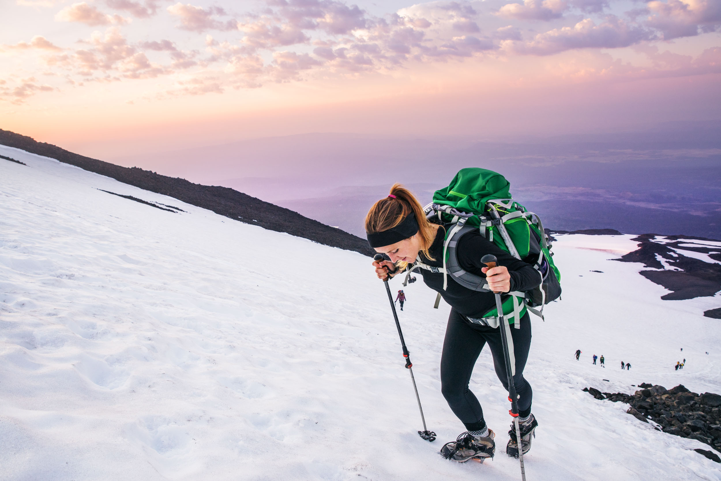 Mountaineer climbing Mt. Adams at sunrise
