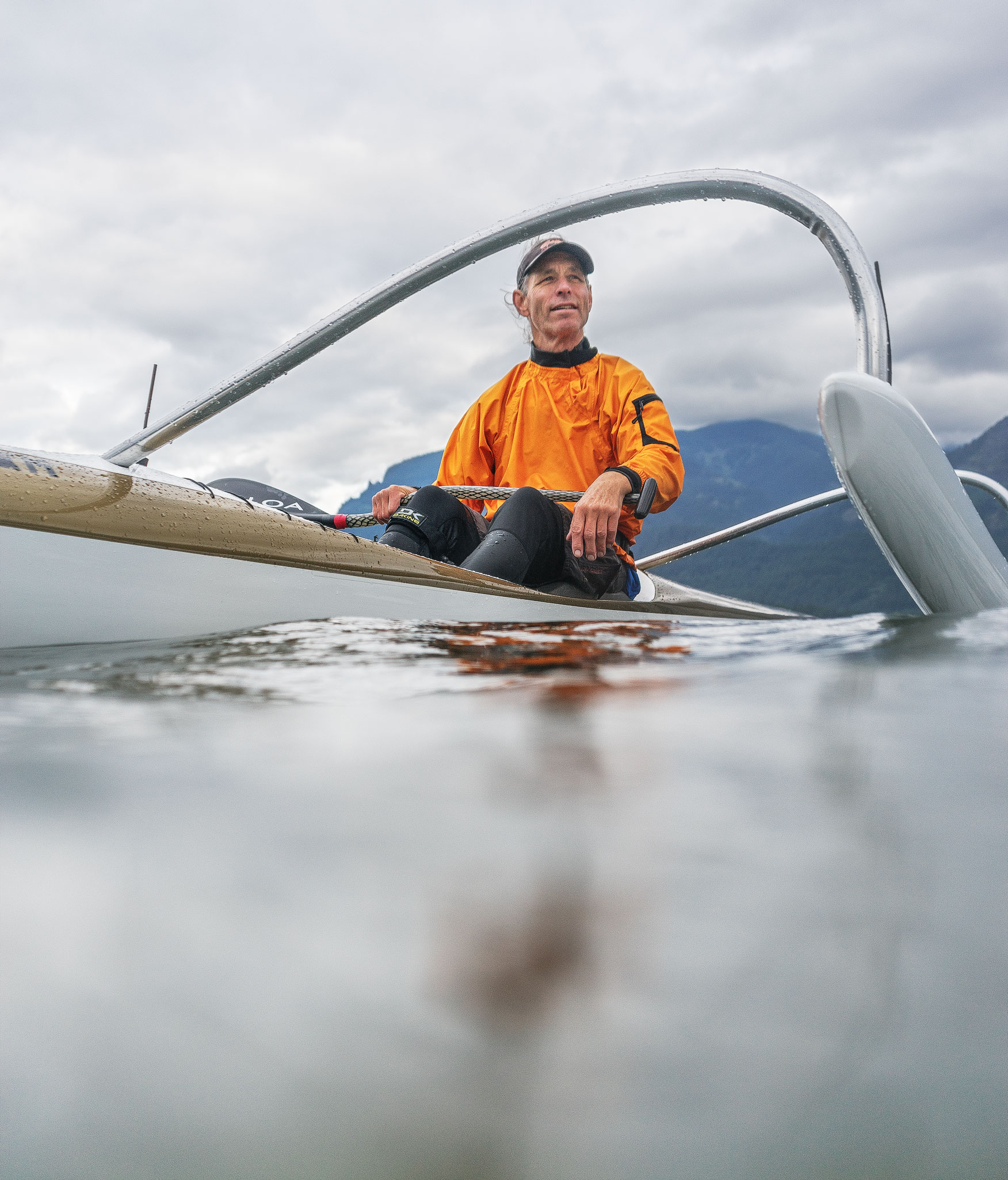 Man sitting in an outrigger canoe