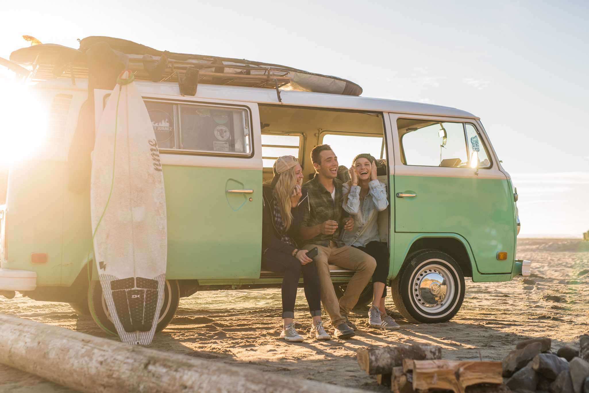 Friends hanging out  on the Oregon coast with a VW Bus.