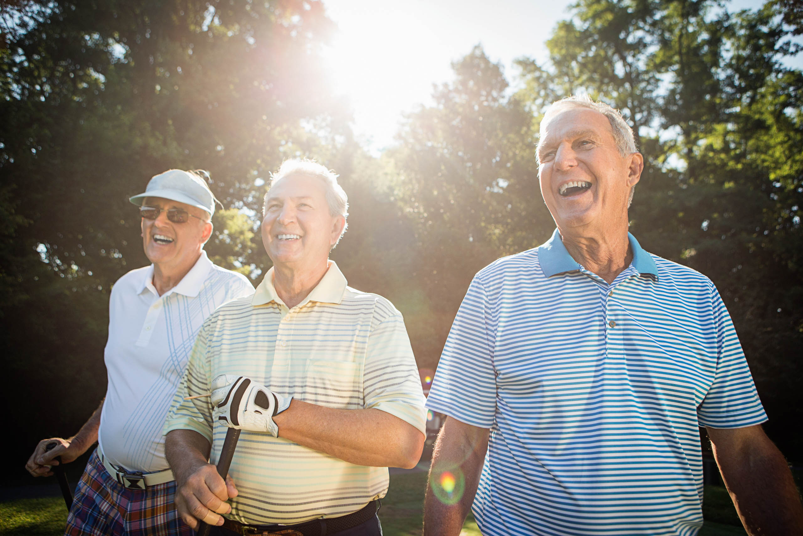 Three senior men on golf course