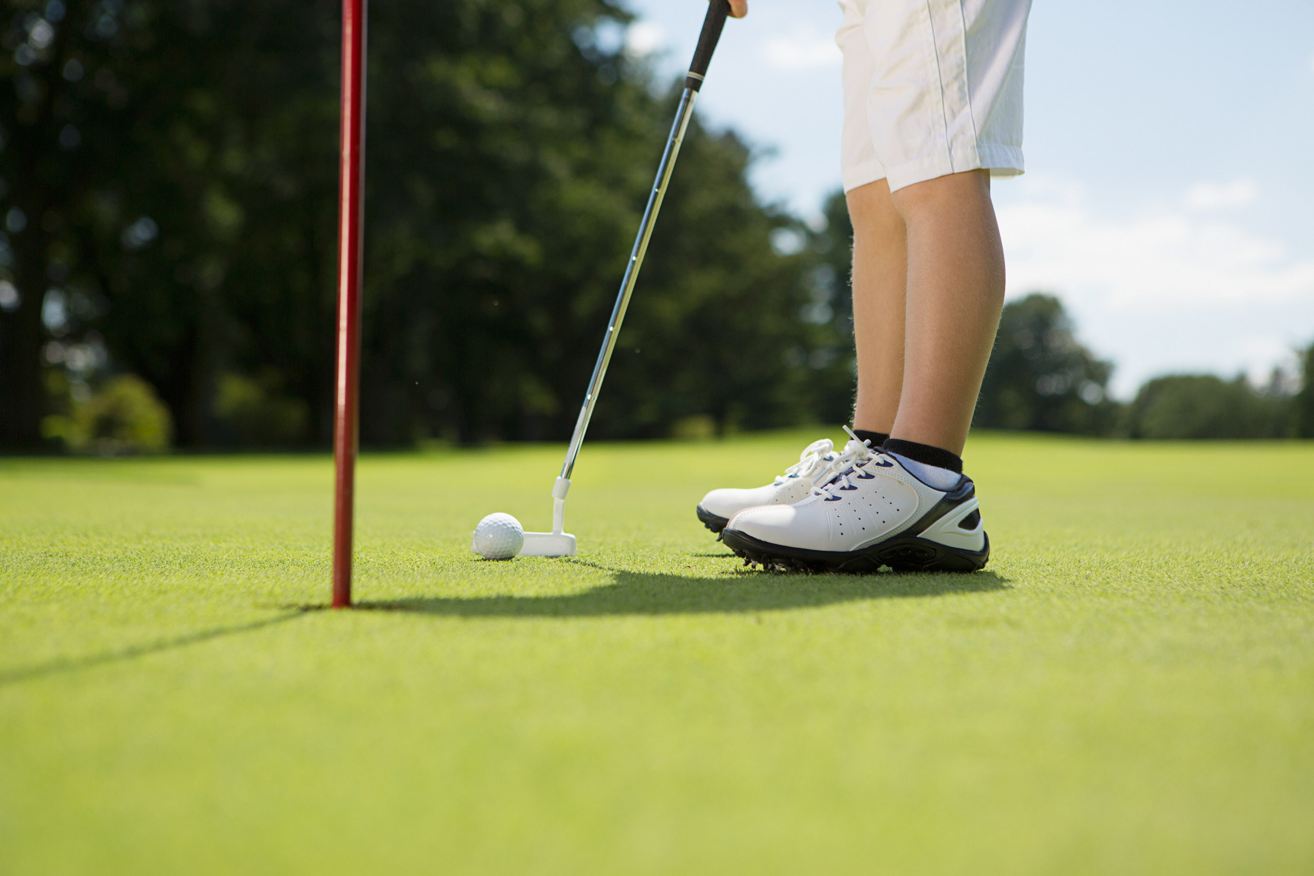 Close up view of boy playing golf