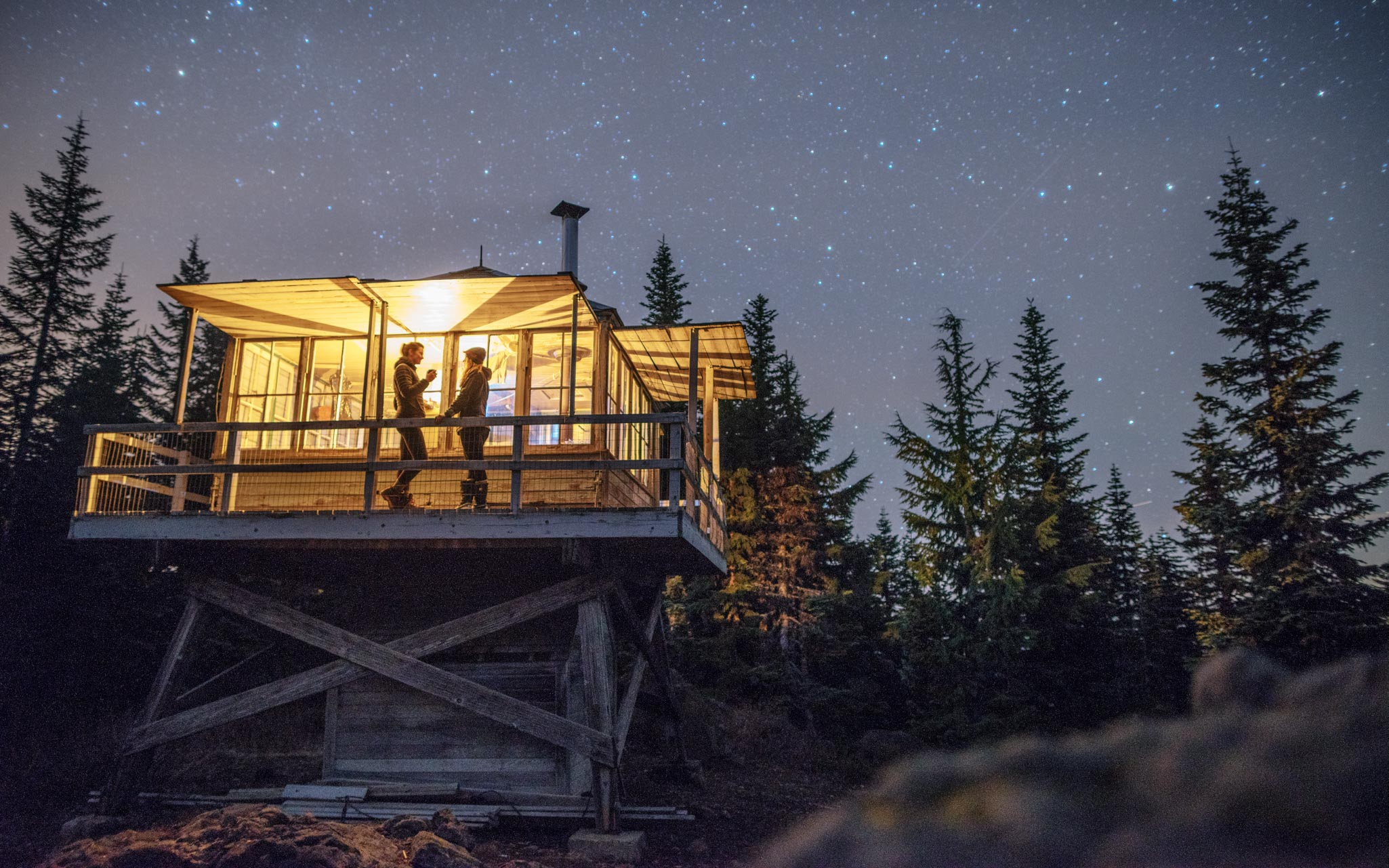 Fire Lookout Tower at night with stars in the sky