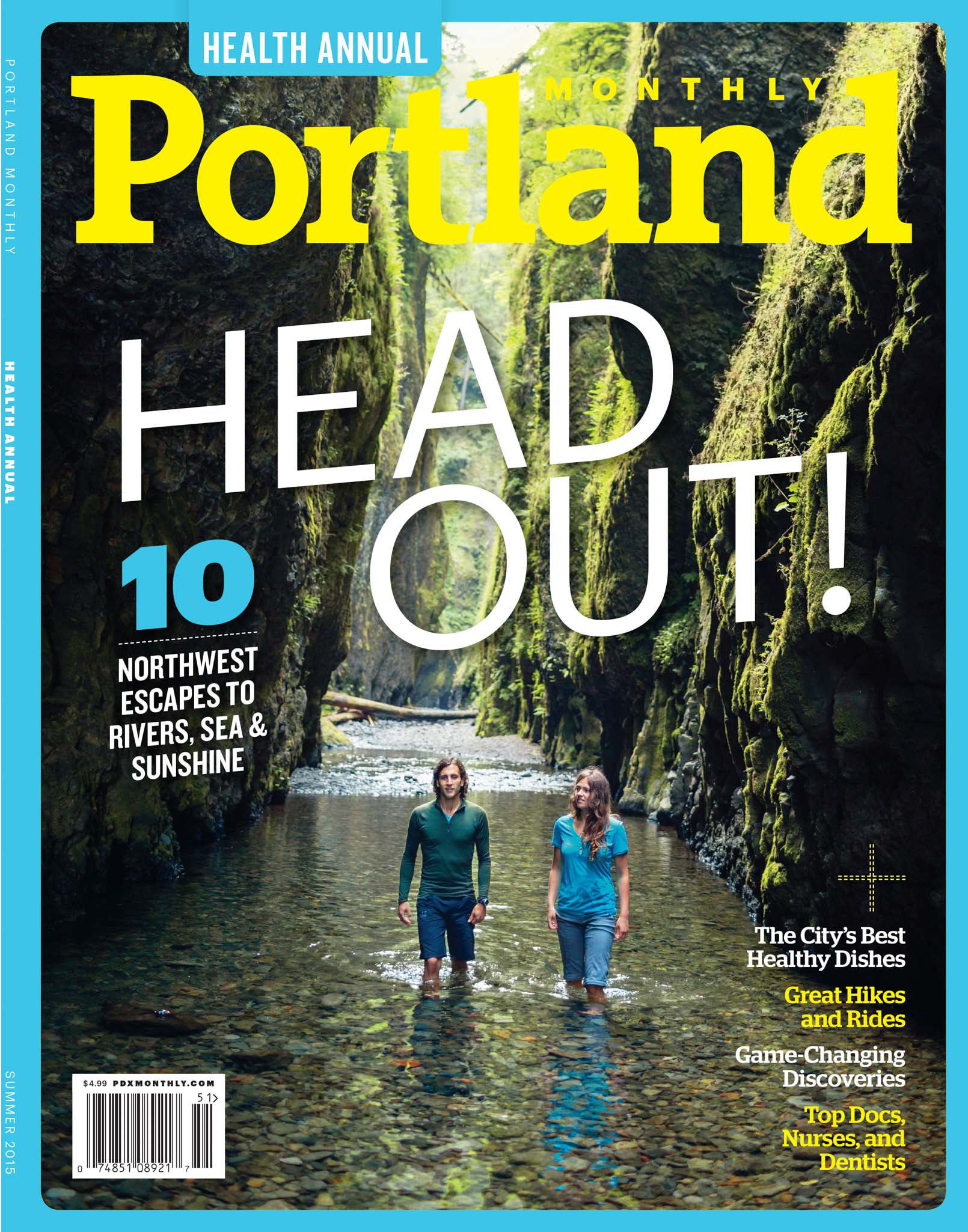Two people wading through Oneonta Gorge