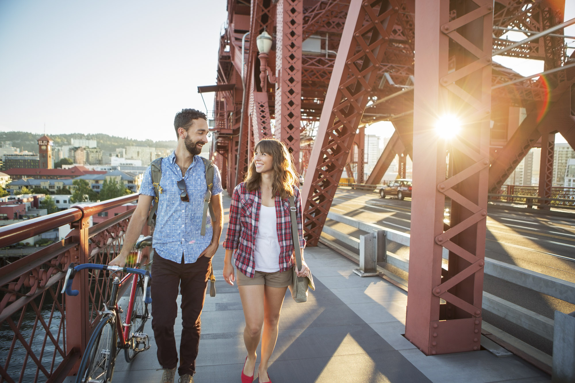 Couple Walks Across Bridge