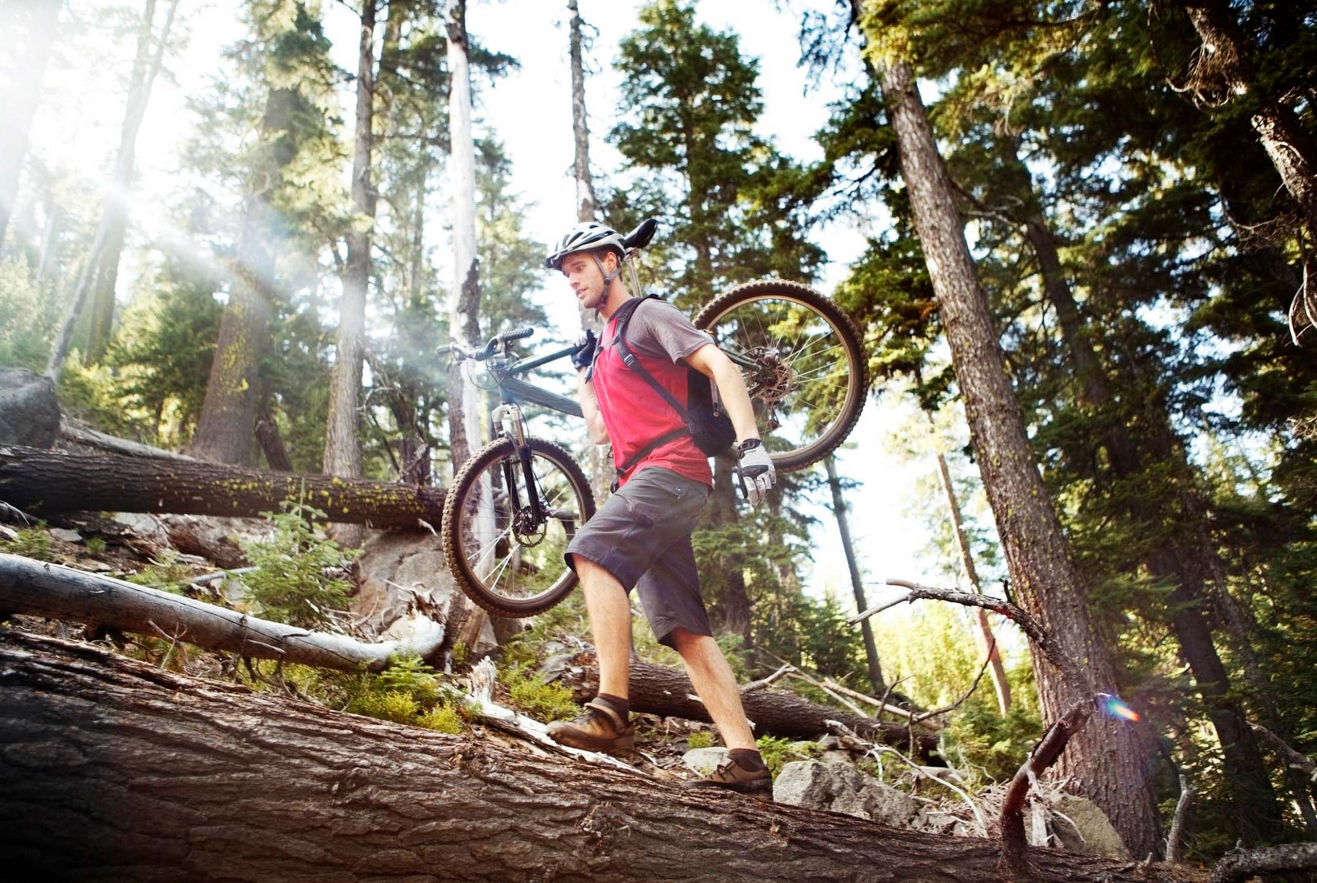 Mountain Biker Carries Bike