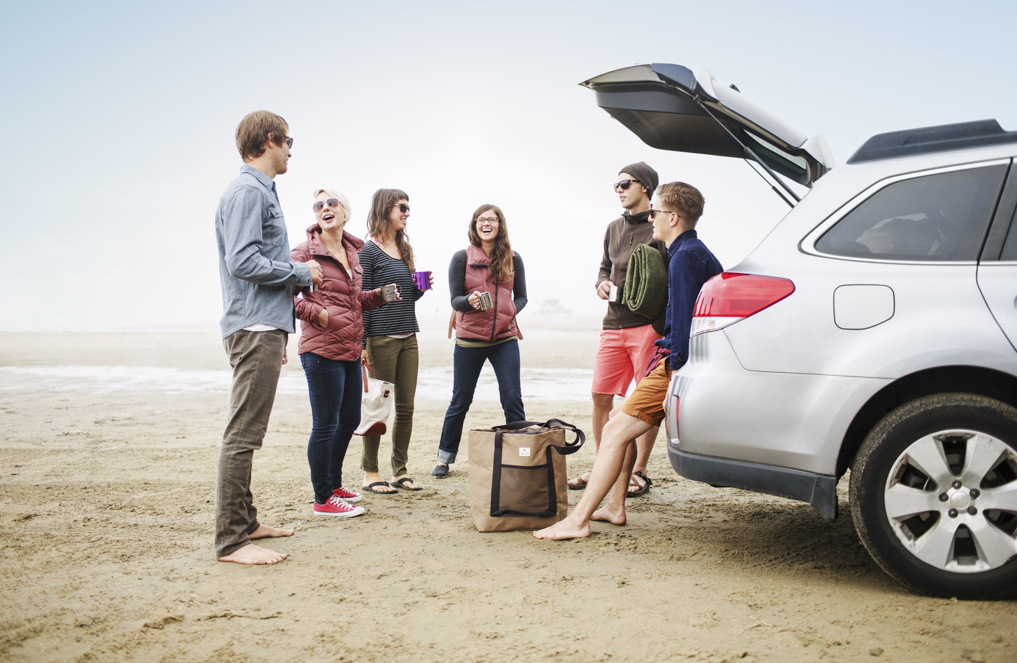 Group gathers around car