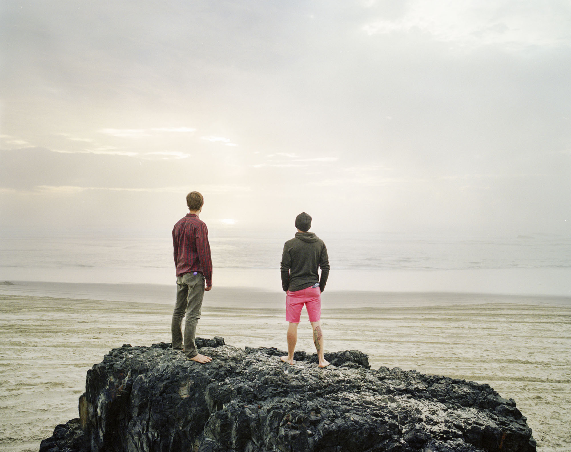 Two men standing on rock