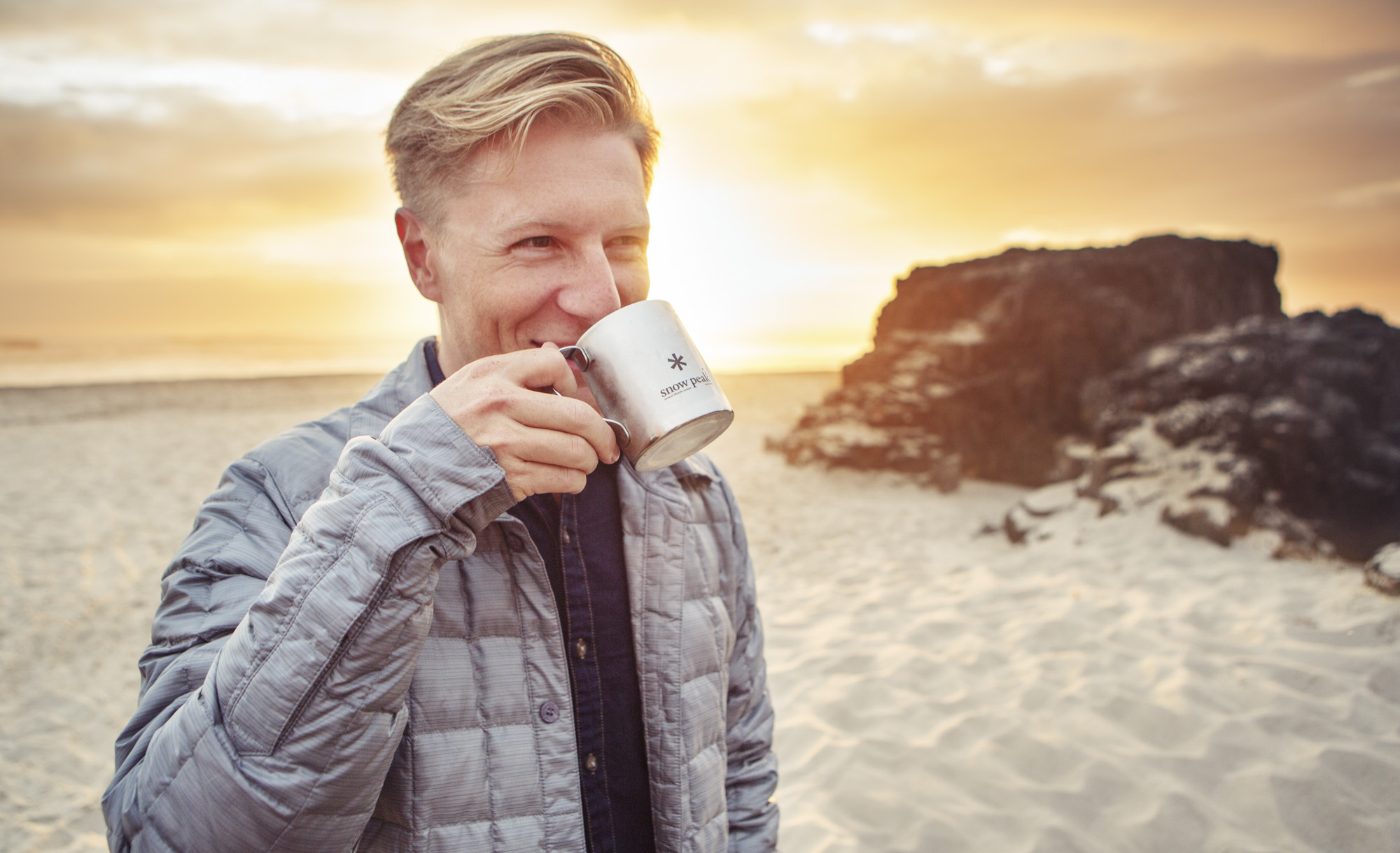 Man enjoys cup of coffee