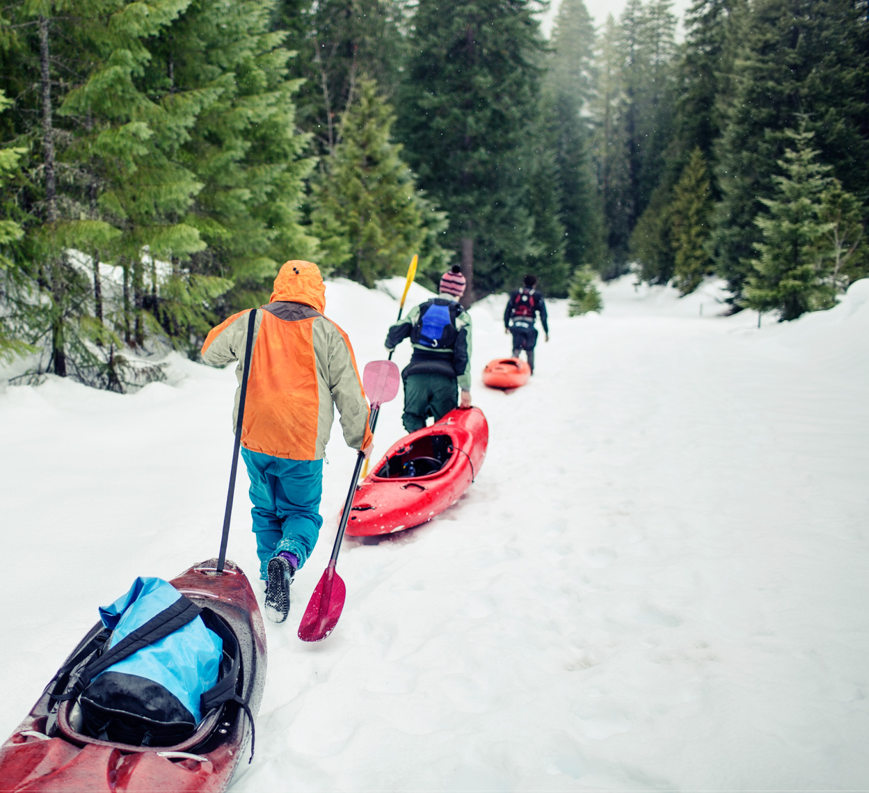 Kayakers Hike Through Snow