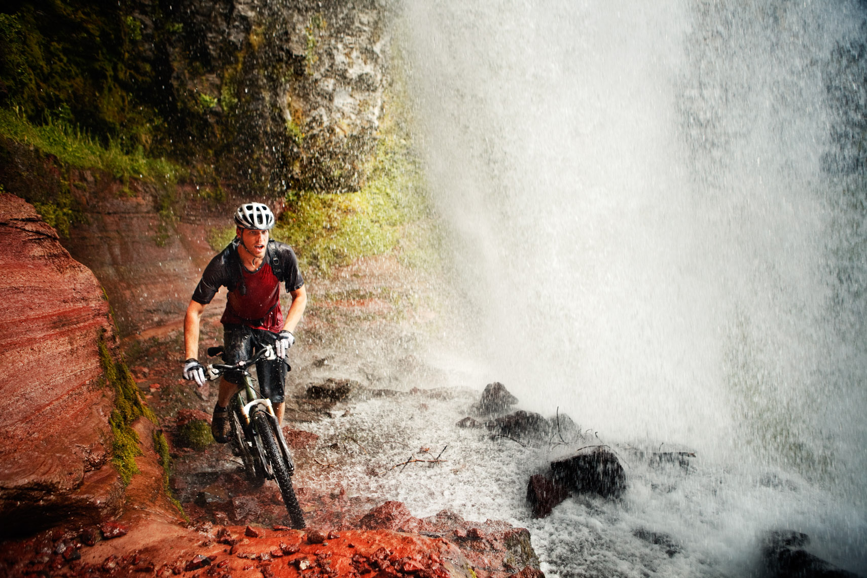 Mountain Biker Behind Waterfall