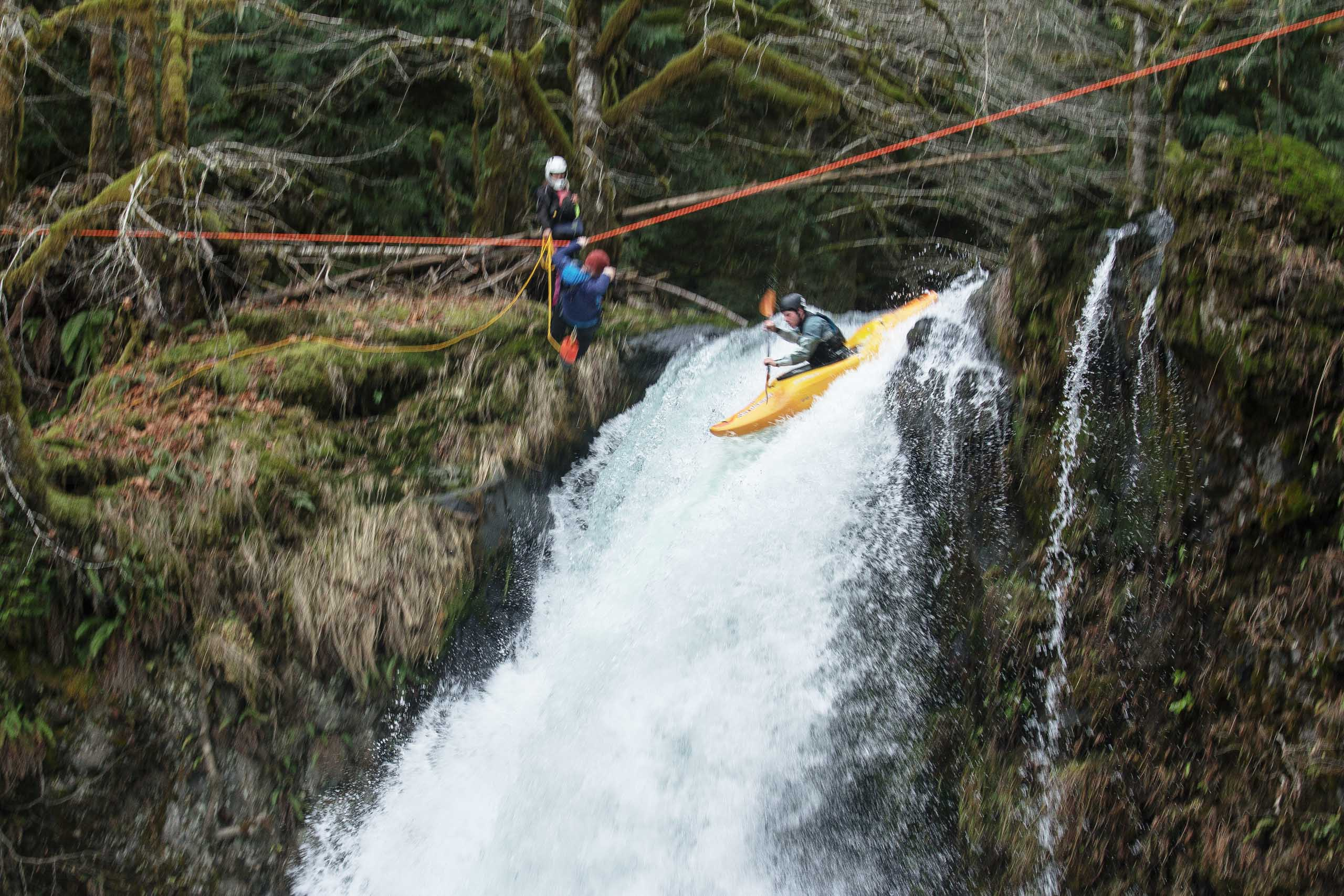 shooting white water kayakers hucking waterfall